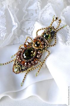 As someone who loves insects and spiders, I adore this beaded beetle from the artistry of Agija Rezcova