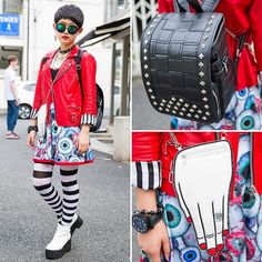 14-year-old Moeka (@kaemoooo) on the street in Harajuku wearing a Hellcatpunks eyeball dress and biker jacket with a Glad News hand-shaped purse and Glad News studded randoseru.