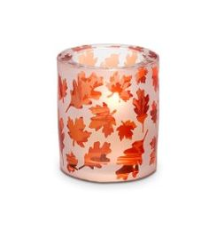 "Autumn Glow Votive Holder: A warm fiery glow is just right for the season. A votive or tealight, sold separately, flickers through an orange leaf motif for a brilliant fall display. Acid etched glass with sprayed color finish. 3""h, 2""dia.    www.partylite.biz/kristinschaeppi"