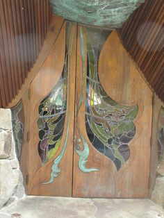 Swirling shapes on the entry doors suggest ocean waves.