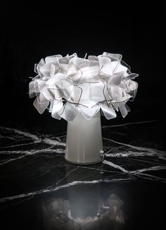 The #botanical cordless table lamp, complete with #rechargeable batteries, can be easily moved from place to place, bringing soft illumination to every situation. It is a fitting #decoration for professionals looking to give a #romantic, glam touch to their téte-a-téte events held on balconies, and in cafés and restaurants; lighting that makes way for endless imagination and creativity. Discover #Clizia table Battery Powered now: www.slamp.it