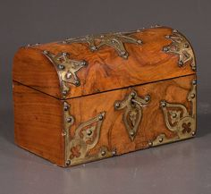 """handsome Sheraton brass bound tea caddy in walnut with dome top and fitted interior. c.1880   9 X 6 X 6"""" high"""