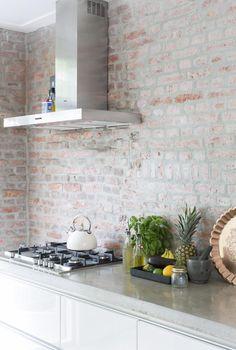 Antique whitewashed brick wall contrasts with modern kitchen design Brick Accent Walls, Exposed Brick Walls, Brick Wall Kitchen, New Kitchen, Kitchen Backsplash, Backsplash Ideas, Kitchen Shelves, Best Kitchen Designs, Modern Kitchen Design