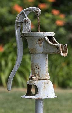 "An old water pump. This was how we got water from the farm up on the ""Adams farm"" when we were enjoying time at the lake with the Cunningham Clan. There was no running water on either site but it didn't feel like ""roughing it."" I miss the experiences at the cabins with family. Everything felt normal and sane while we were there."