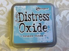 "Distress+Oxide+Ink+by+Tim+Holtz+""Broken+China​​​""+is+a+product+of+Ranger.+A+combination+of+pigment+and+die+ink+this+stamp+pad+(full+size)+is+perfect+to+use+on+your+paper+projects+or+many+other+crafting+endeavors.+The+combination+of+the+two+types+of+inks+lend+themselves+to+unique+blending+and+and+distressing+techniques.++3""+x+3""++​FREE+SHIPPING+ON+US+ORDERS+$75.00+or+more.+Shipping+overages+refunded."