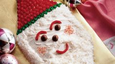 Looking for a yummy dessert? Then check out this cake made in creative Santa shape – perfect for Christmas celebration.