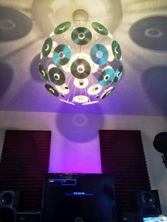 Chandelier DJ Style. Cute idea for the kids room. A light made with CDs.