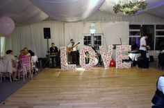 Marquee LOVE letters on the dance floor for the wedding decor Function Room, Wedding Decorations, Table Decorations, Greggs, Well Dressed, Wedding Venues, Floor, Letters, Dance