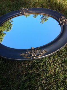 Originally gold, this mirror was painted in Annie Sloan Chalk Paint - graphite color, then distressed to bring up the gold, waxed in clear and dark waxed and buffed to a beautiful sheen.