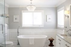 free standing tub with chandelier above!