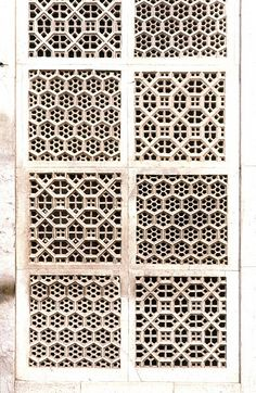 Latticework from the Akbar's Tomb, in Sikandra, India, showing Geometric Pattern using carved masonry or stone relief.