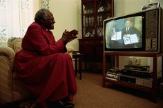 Archbishop Desmond Tutu applauds as he watches Nelson Mandela and South African President FW de Klerk receive the Nobel Peace Prize for ending apartheid in South Africa. Tutu won the peace prize in 1984 for his work in civil rights Pushpa Padayichie