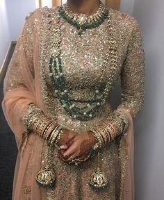 Blush pink bridal lengha + dark green jewelry