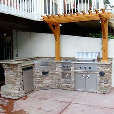 A Grill Island & Outdoor Kitchen with Built-In Gas Grill, Side Burners & Stereo