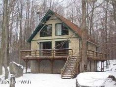 THIS IS IT!!!! CHARMING CHALET ON LARGE LEVEL WOODED LOT IN THE HIDEOUT.THE PERFECT VACATION HOME IN A PEACEFUL, TRANQUIL MOUNTAIN SETTING. FEATURES  2 BEDROOMS AND FULL BATH ON FIRST FLOOR AND AN OVERSIZED LOFT ON THE 2ND FLOOR. STAIRS DOWN TO STAND UP BASEMENT/ CRAWL SPACE W/WASHER/DRYER HOOK-UP. LARGE DECK IN FRONT AND REAR FOR ENTERTAINING OR JUST ENJOYING YOUR PRIVATE BACK YARD. PRICED FOR A QUICK SALE!!!