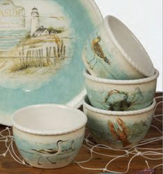 Beach Cottage Ice Cream Bowls, by Certified International. Lovely ocean-inspired ceramic dishes in a soothing color palette of neutral sands, ivory, and beach-glass-blue. Features artwork of sea birds, blue crabs, and red lobsters, by Susan Winget. This is for the Ice Cream Bowls, sold as a set of FOUR (1 each of the images shown in photo). Measures 5.5 x 3...