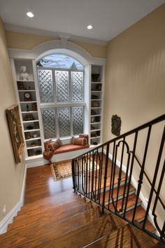 Love this landing in the middle of the staircase. The perfect reading nook