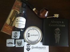 The Deluxe Beard Care Kit is the Ultimate Gift for a Modern Gentleman. It comes with an engraved Whiskey Flask and Whiskey Stones, Handcrafted Briar Wood Pipe, Scented Beard Balm & Beard Oil and a Kent Mustache Comb. You can purchase online and ship world wide from the U.S. at www.gentlemansbeardbalm.com/beard-care-products/beard-care-kits/