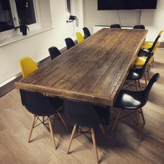 This beautiful hand made reclaimed wood boardroom table is a real centre-piece for any stylish office or meeting room.Made using reclaimed scaffold boardsand a tapered rectangularbox steel legs,the tableshows clear signs of a full industrial life, but issanded back carefully for an enjoyable dining experience.  Thisboards are finished in a medium brown wood dye before being given agenerous layer of clear satinOsmo Poly Oilto protect it from daily use.  Sizes:  Our boardroom tables…