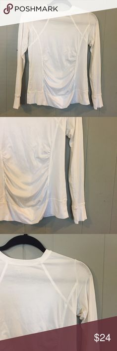 CAbi white top with rouching CAbi white long-sleeve top. Rouching down middle. Wide hem on bottom and on sleeves. Seams for a flattering fit. 95% cotton, 5% spandex. Pre-loved – great condition, no major signs of wear, rips or stains. Measurements (approximate): Underarm to underarm: 18 inches Shoulder to hem: 24 inches CAbi Tops Tees - Long Sleeve