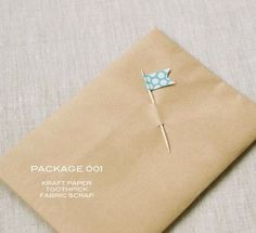 Cute gift wrap embellishment for plain craft paper with a scrap fabric (or paper) toothpick flag❣