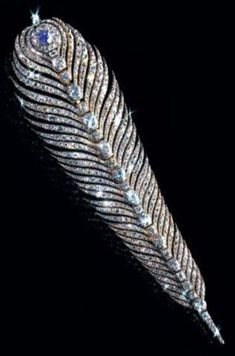 Louis XVI's gift to Marie Antoinette. Spectacular old mine cut diamond and sapphire oversized feather. Louis XVI was tired of Marie Antoinette's taste for tall headdresses, and offered her this diamond aigrette to wear instead.