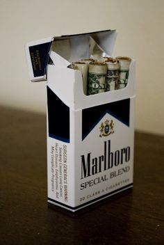 """Money saving reminder: I'm going to have to remember this image when I want to buy my """"occasional social smoker pack"""". I bet if the cigs were wrapped in money no one would smoke."""