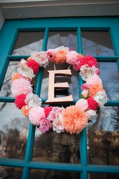 Hand made pom pom and flower wreath for a little girls first birthday party.