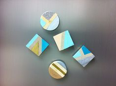 Skinny strips of painter's tape on wood magnets make color blocking easy. | 13 DIY Projects To Make Your Home More Colorful