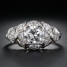 Antique Diamond Ring - I love the idea... it would look nice with a marquee center east/west & a the diamond a little more focused