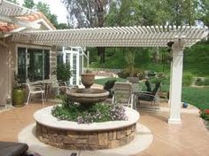 side view of pergola patio - like the small slats that make lots of shade!