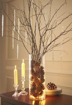 twigs, cones, candles, and cmas lights = beautiful