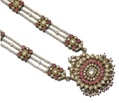Enamel, cultured pearl, ruby, colorless sapphire, tourmaline, spinel and diamond sautoir. Set with foiled back fancy-shaped rose diamonds, foiled back cabochon rubies, colourless sapphires, spinels and tourmalines, hardstone beads and seed pearls, the reverse decorated with floral and foliate polychrome Jaipur enamel, length adjustable from approximately 670mm to 860mm, a few small beads and pearls deficient. Indian or Indian style