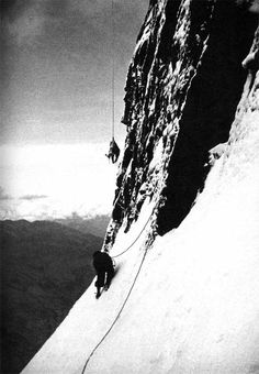 The hanging body of Toni Kurz on the north face of the Eiger being retrieved by a rescuer, 1936.