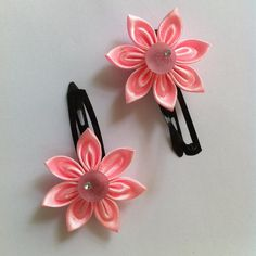 This tutorial shows how to make this beautiful littlesatin ribbon flower that fits perfectlyon a hair snap. Once you master the technique, make them in other colors to complement with your little girl's wardrobe.    Materials   satin ribbon felt embellishments hair snaps scissors candle and lighter fabric glue