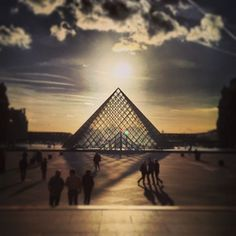 The museum entrance designed by I M Pei in 1989. The pyramid instantly became an landmark for the city of Paris.