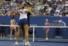 Ekaterina Makarova (in white shirt) and Elena Vesnina, both from Russia, celebrate after defeating Martina Hingis of Switzerland (rear, R) and Flavia Pennetta of Italy in the women's doubles final match at the 2014 U.S. Open tennis tournament in New York, September 6, 2014. REUTERS/Mike Segar