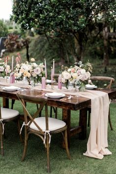 If we don't do a floral runner, I like this loose blush chiffon draped fabric runner with 4-5 centerpieces down the table - forming more of a low wall of flowers down the middle