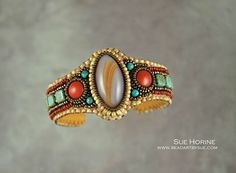Striped agate and red jasper cuff by Sue Horine