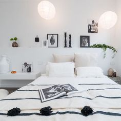 Stripes with Pom poms, I love the neutral sophisticated but fun look in this bedroom