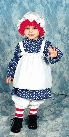 #12112/12114 She'll make the perfect Rag Doll this Halloween as Raggedy Ann. The Raggedy Ann Costume includes a white an blue dress with attached apron and striped stocking. The hat with attached wig