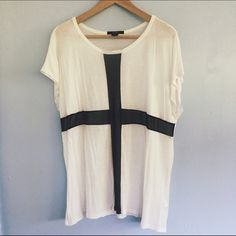 Forever 21 White T-Shirt with Black Mesh Cross Worn only once. The black cross across the front is made of a mesh (see picture above). Very comfortable and flowy. Forever 21 Tops Tees - Short Sleeve