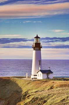 The Yaquina Head Light, also known early in its existence as the Cape Foulweather Lighthouse, is on the Oregon Coast in Lincoln County, near the mouth of the Yaquina River. The tower stands 93 feet tall, and is the tallest lighthouse in Oregon. Lighthouse Pictures, Lighthouse Art, Lighthouse Keeper, Lighthouse Quotes, Lighthouse Drawing, Lighthouses In Oregon, Bay Lights, Am Meer, Oregon Coast