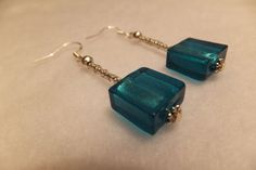 Check out this item in my Etsy shop https://www.etsy.com/listing/185796194/turquoise-tide-sea-glass-earrings