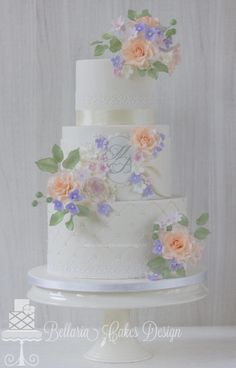 Ivory wedding cake with pastel flowers - Cake by Bellaria Cakes Design