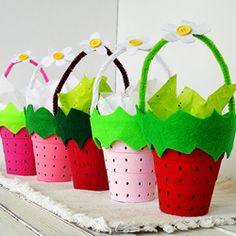 Filled with treats, these cute little cups would be perfect for a strawberry party!