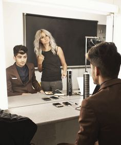 Lou and Zayn. is just sitting there looking like a model