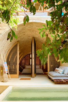The hotel was designed to integrate with the landscape and to offer comfortable spaces for reflection. Puerto Escondido Oaxaca, Unique Architecture, Interior Architecture, Brick Arch, Hotel Room Design, Swimming Pool Designs, House In The Woods, Hotels And Resorts, Windows And Doors