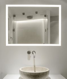Copenhagen Penthouse by Dannish architects Norm Architects. Perfect use of inderect lighting concealed behind a mirror.