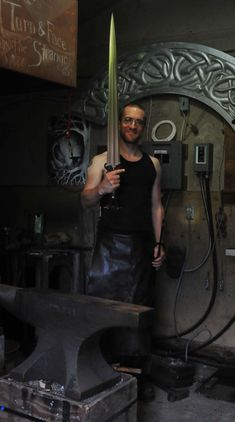 Jake Powning holding the bronze sword he made for the Exhibition The Sword - Form and Thought.